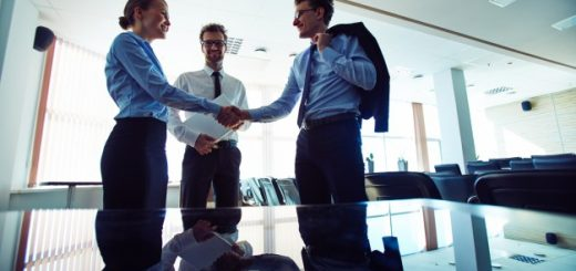 businesspeople-shaking-hands-at-workplace_1098-4112