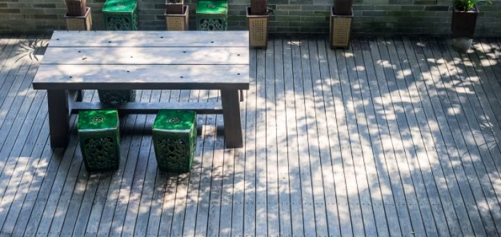 terrace-with-a-wooden-table-and-plants_1137-267